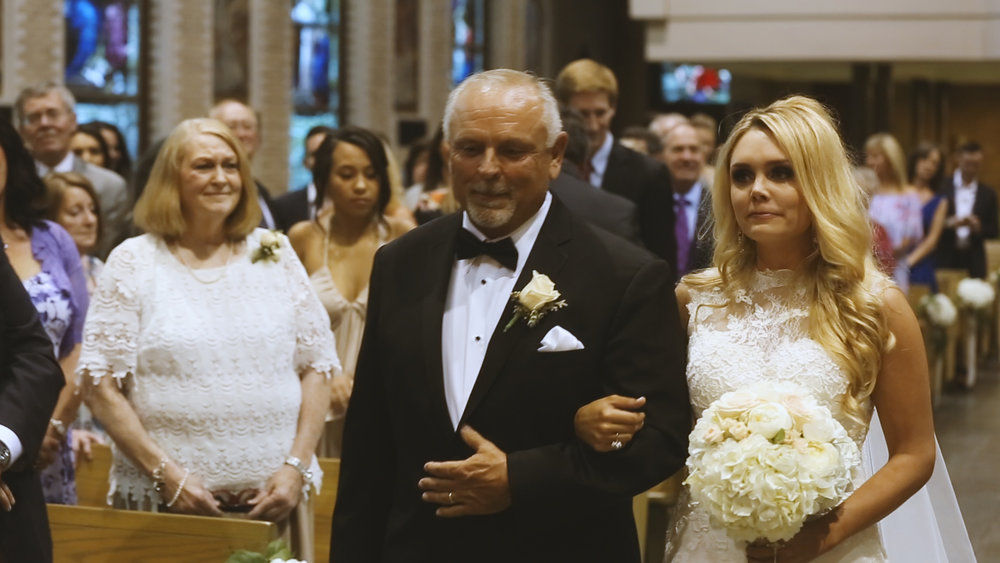 BrideFilm_Baton Rouge Wedding Videography_bride walking down aisle reaction