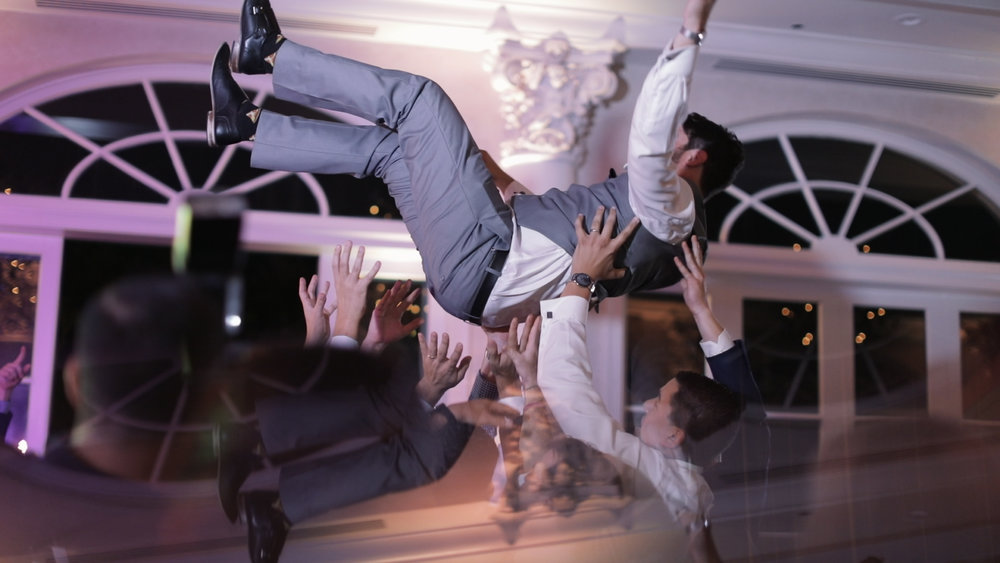 Annalisa and Anthony_New Orleans Wedding videography_reception crowd surfing marche