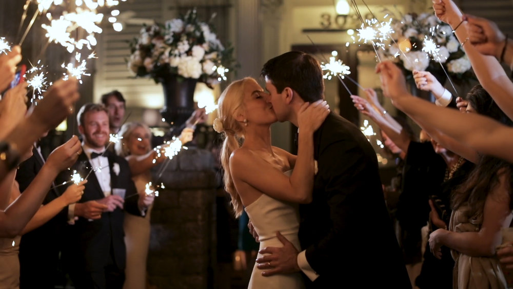 New Orleans Wedding Video_Elms Mansion_Paige and Travis_sparkler exit kiss