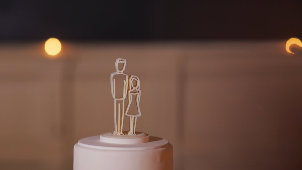 Anya and Max_New Orleans Wedding Video_Bride Film_Board of Trade reception_cake topper