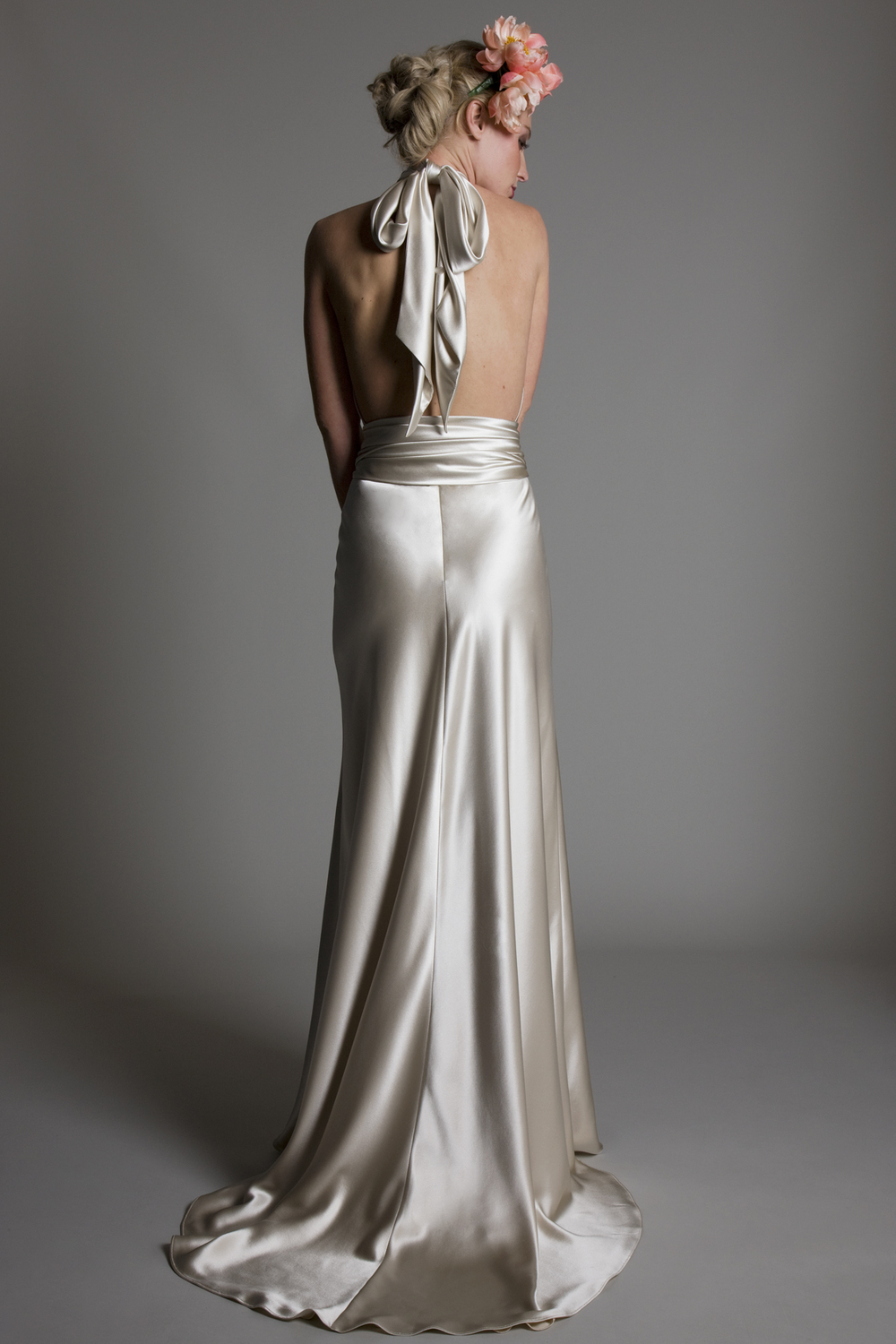 Back view of the Claudia satin halter neck open back bridal wedding dress with satin belt detail by Halfpenny London