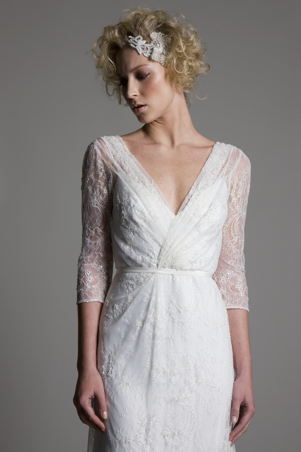 Detailed view of the Josephine wrap front full lace wedding dress with a low V back by Halfpenny London