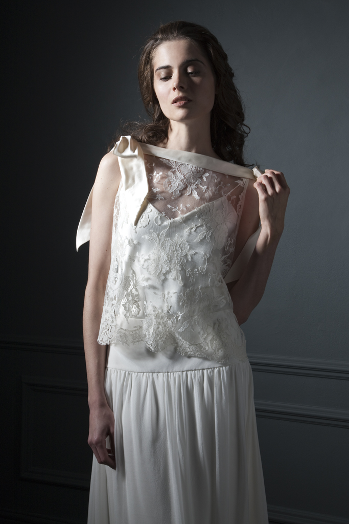 Detailed view of the Irene French Lace high neck Tee with silk bow detailing on the shoulder, paired with the Laura dropped waist chiffon skirt bridal wedding by Halfpenny London