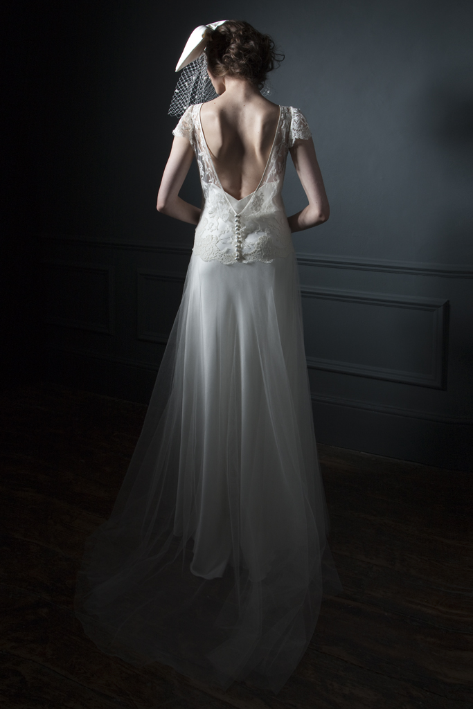 Back view of the Iris classic silk tulle skirt and french lace cap sleeve wedding and silk crepe back satin V Neck and back Slip bridal wedding dress by Halfpenny London