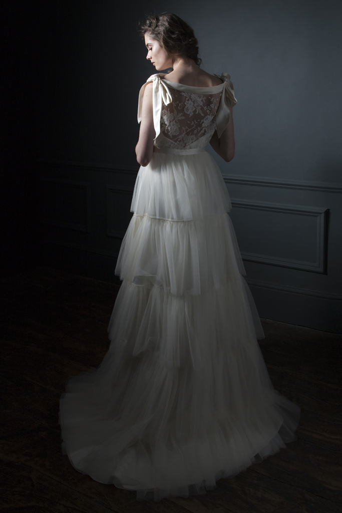 Back view of the Irene French Lace Tee and silk bow shoulder details paired with the Rita silk tulle frill skirt Bridal wedding dress by Halfpenny London