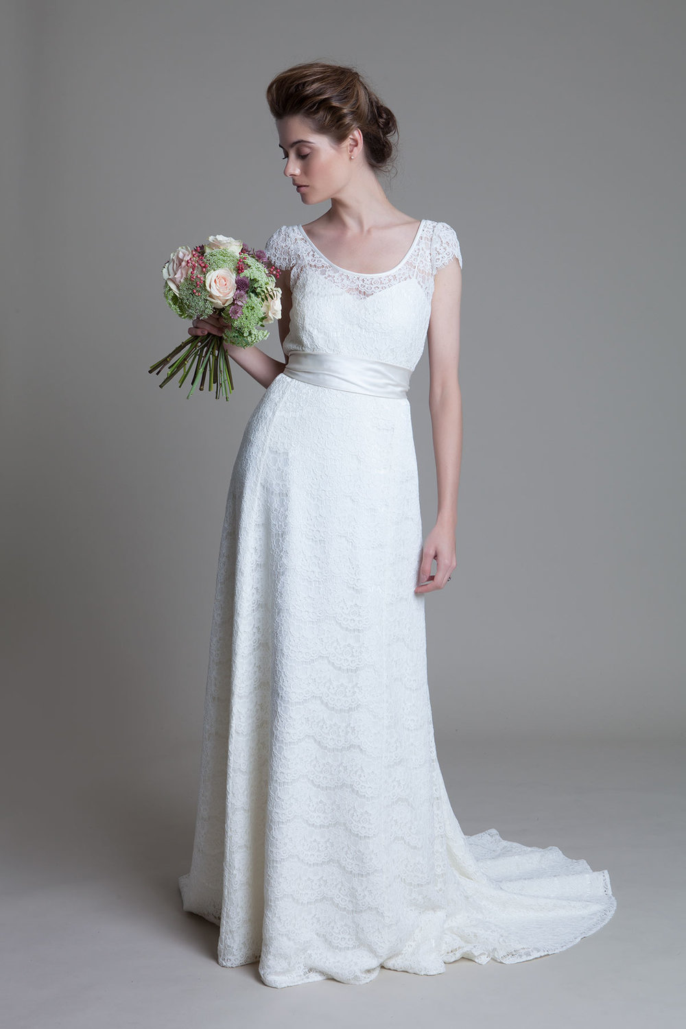 Bella round neck french lace and duchess satin sash bridal wedding dress by Halfpenny London