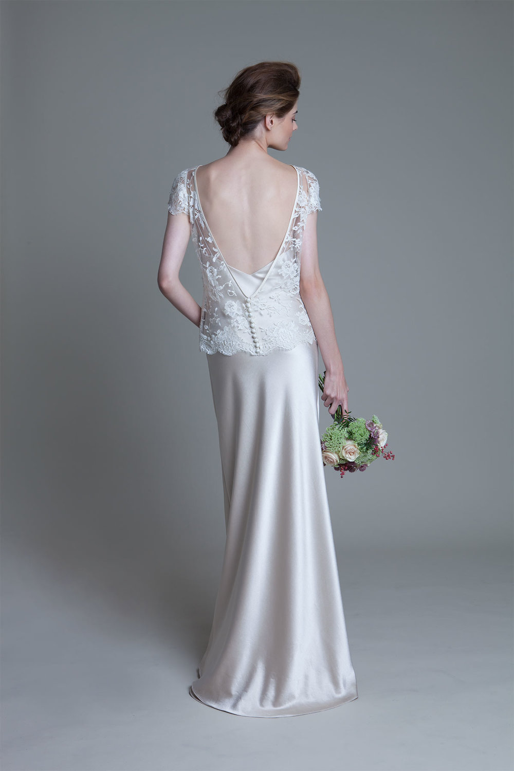 Back view of the Iris classic jacket over a crepe back satin ivory slip wedding dress by Halfpenny London