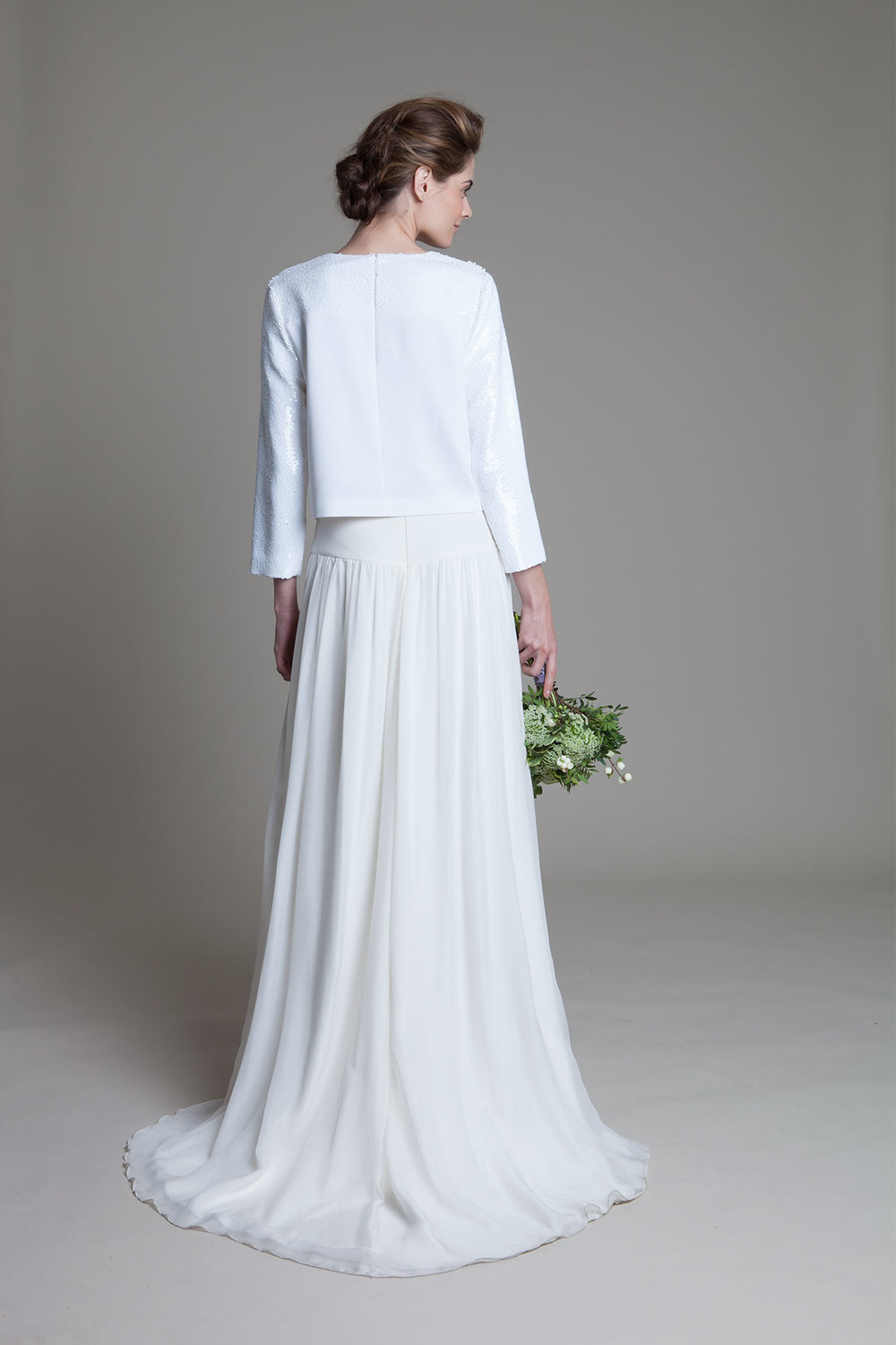 Back view of the Laura ivory chiffon skirt with drop waist and box sequin long sleeve top wedding dress by Halfpenny London