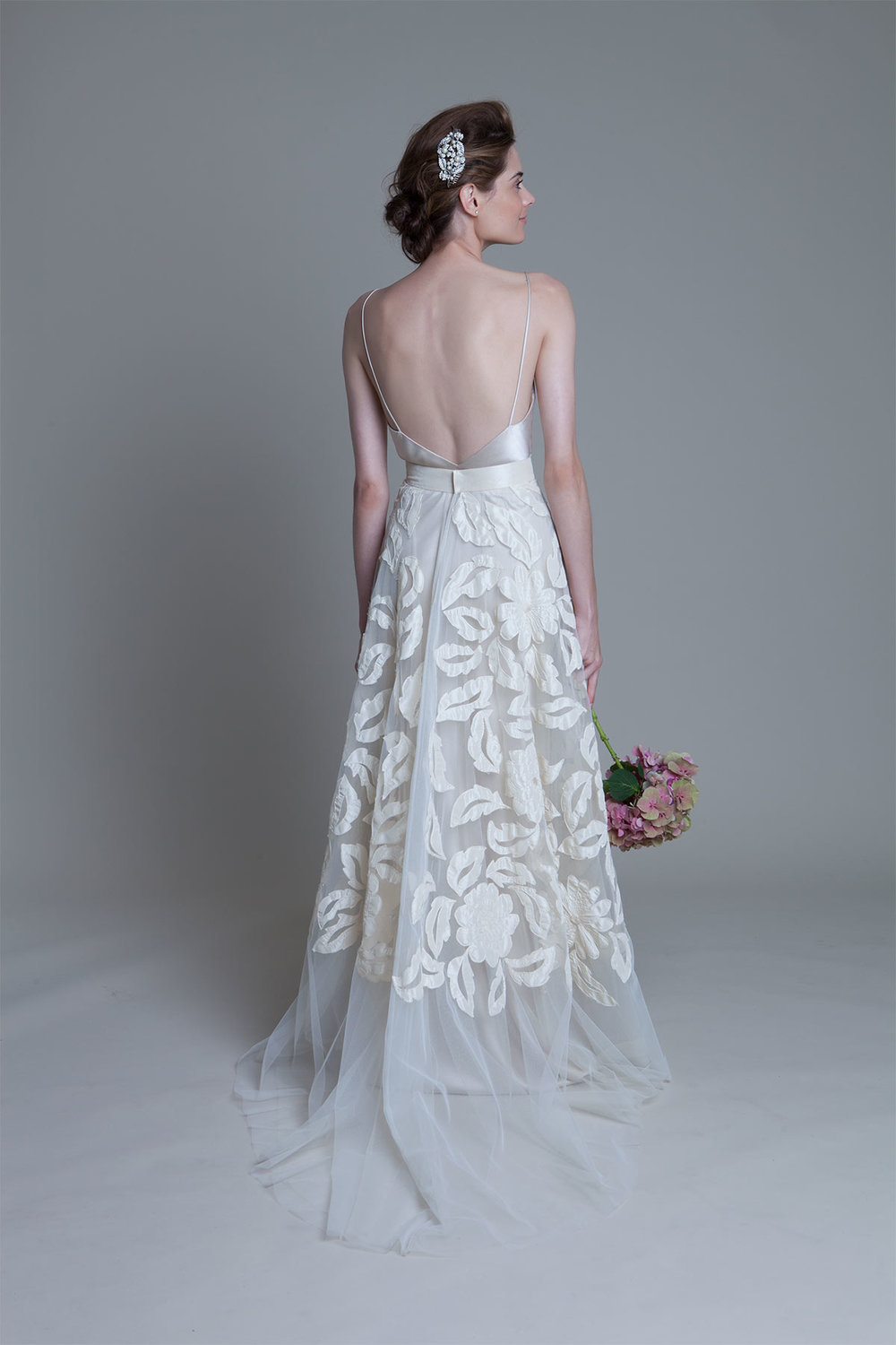 Back view  of the Susie hand applique tulle skirt with iris backless bias cut slip wedding dress by Halfpenny London