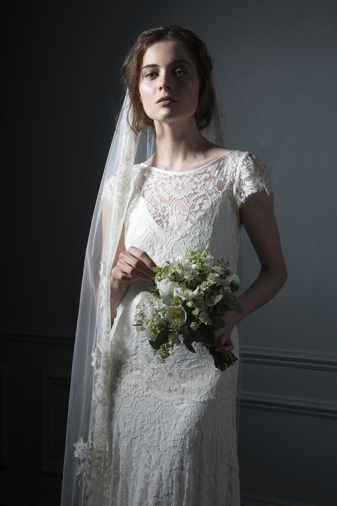 Detailed view of the Violet Full french lace, drop waist, high neck wedding dress with cap sleeves and V neck crepe back silk Slip Bridal wedding dress by Halfpenny London