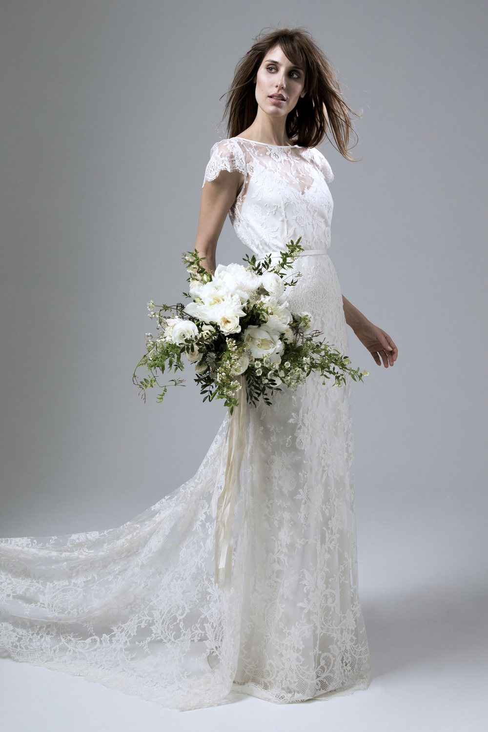 Profile view of the Iris Rose Full French Lace Wedding Dress by Halfpenny London