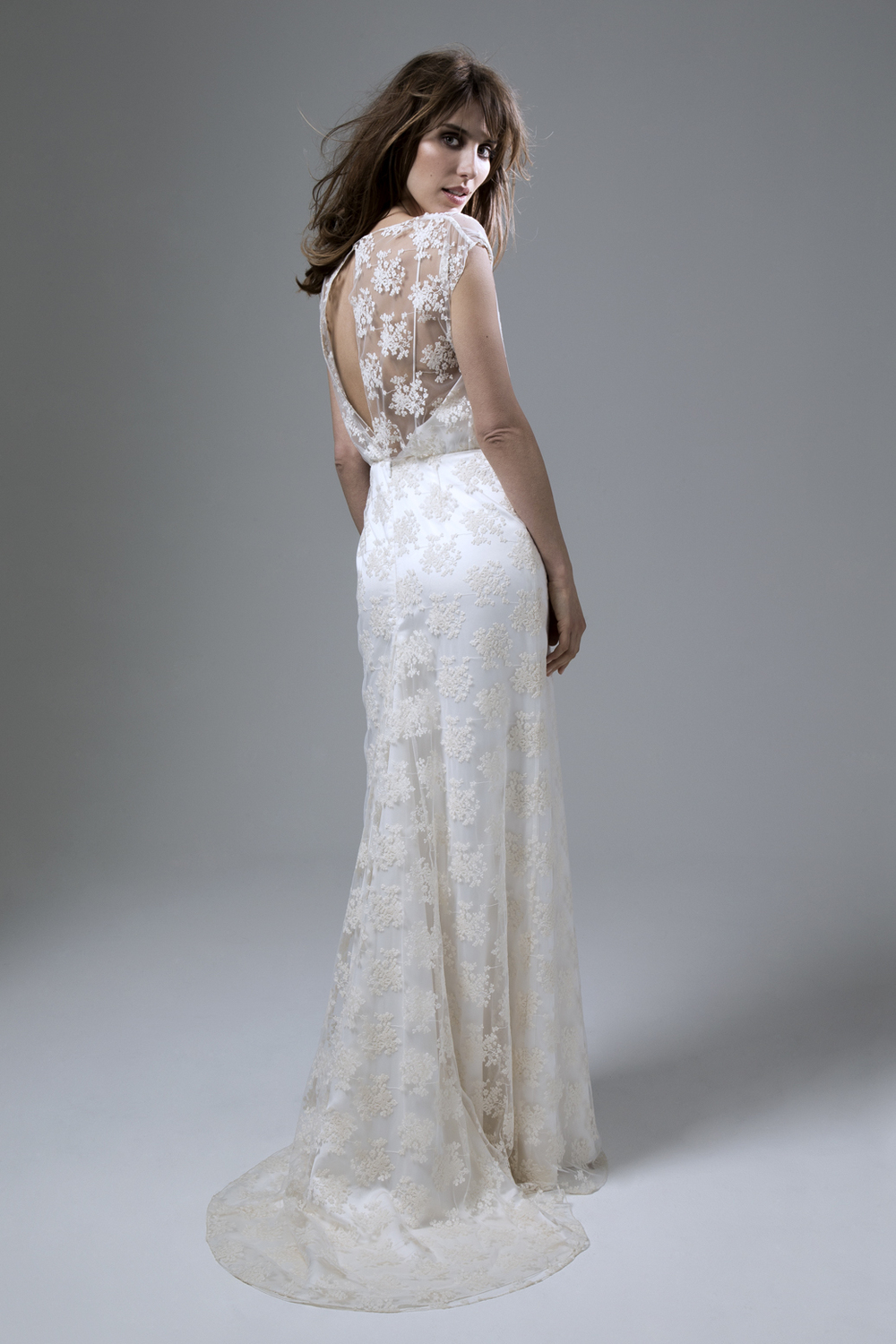 Back View of the Lydia Rose embroidered tulle slash neck wedding dress with puddle train by Halfpenny London