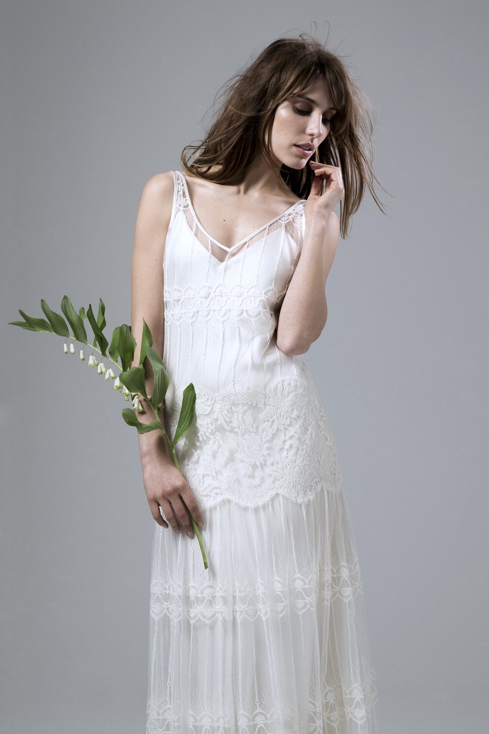 Detailed view of the Marilyne V neck French Lace and Chantilly lace wedding dress by Halfpenny London