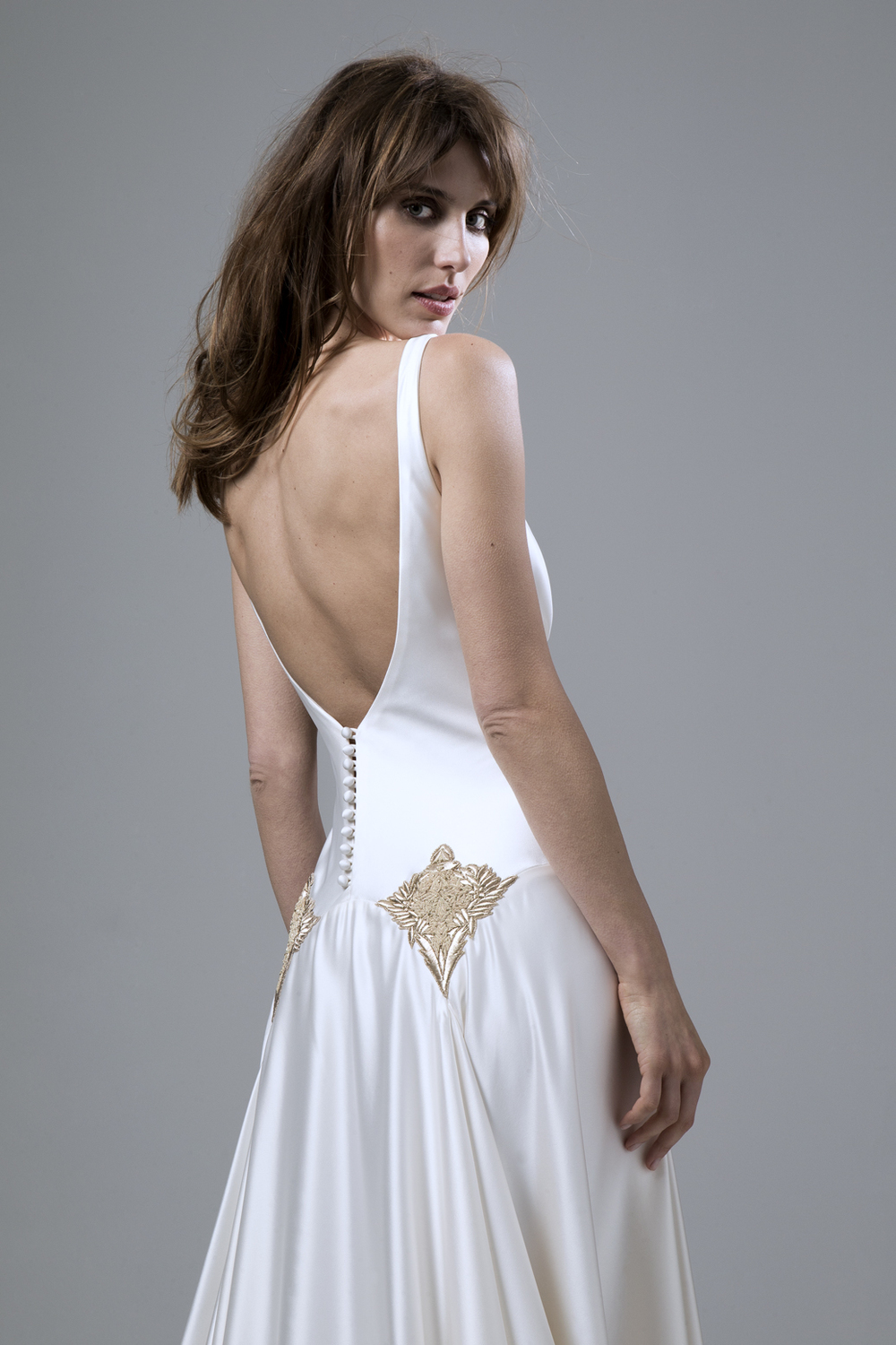 Detailed back view Milly Bafta V neck and low V back wedding dress with godgets and embellishment detailing by Halfpenny London