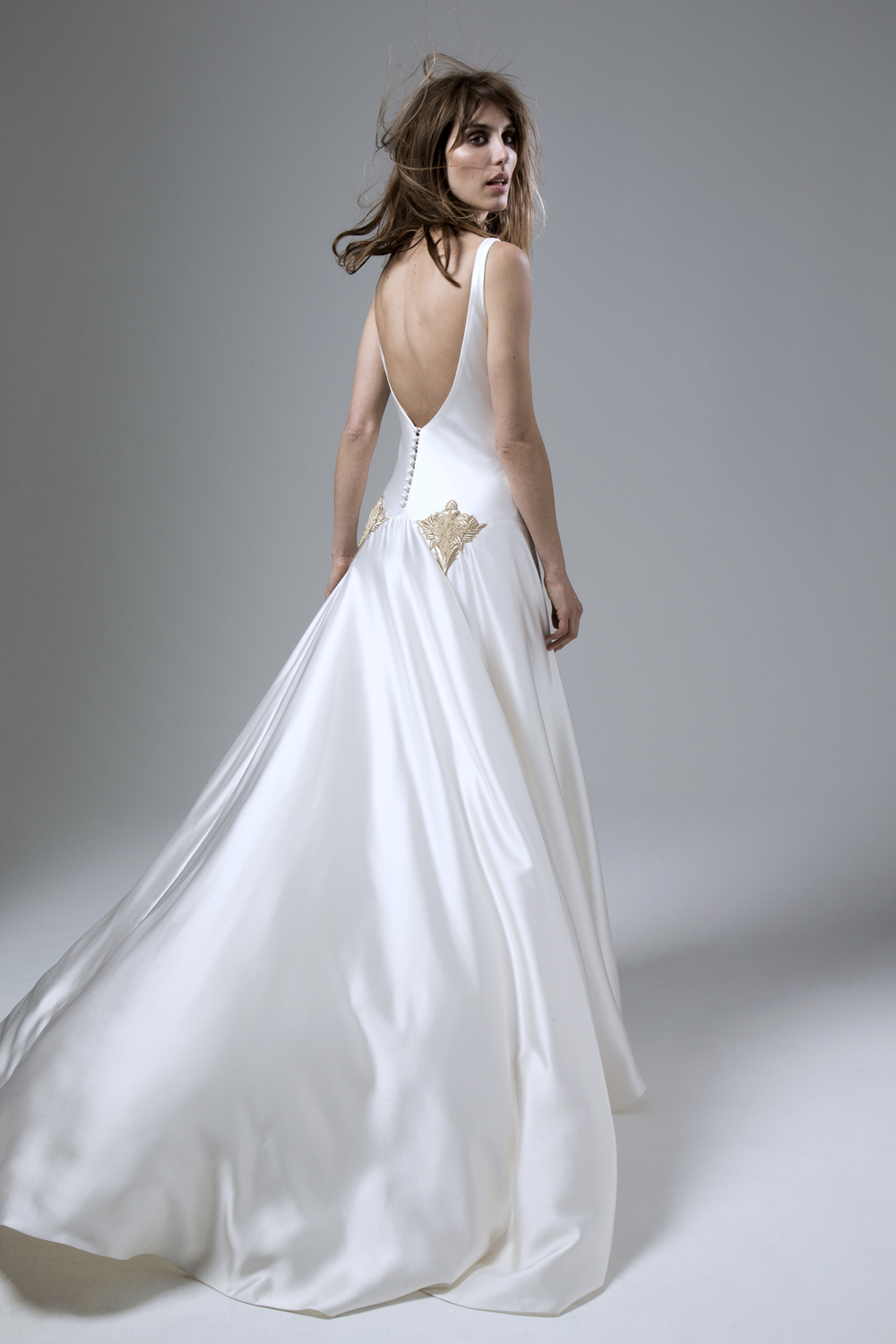 Milly Bafta V neck and low V back wedding dress with godgets and embellishment detailing designed by Halfpenny London