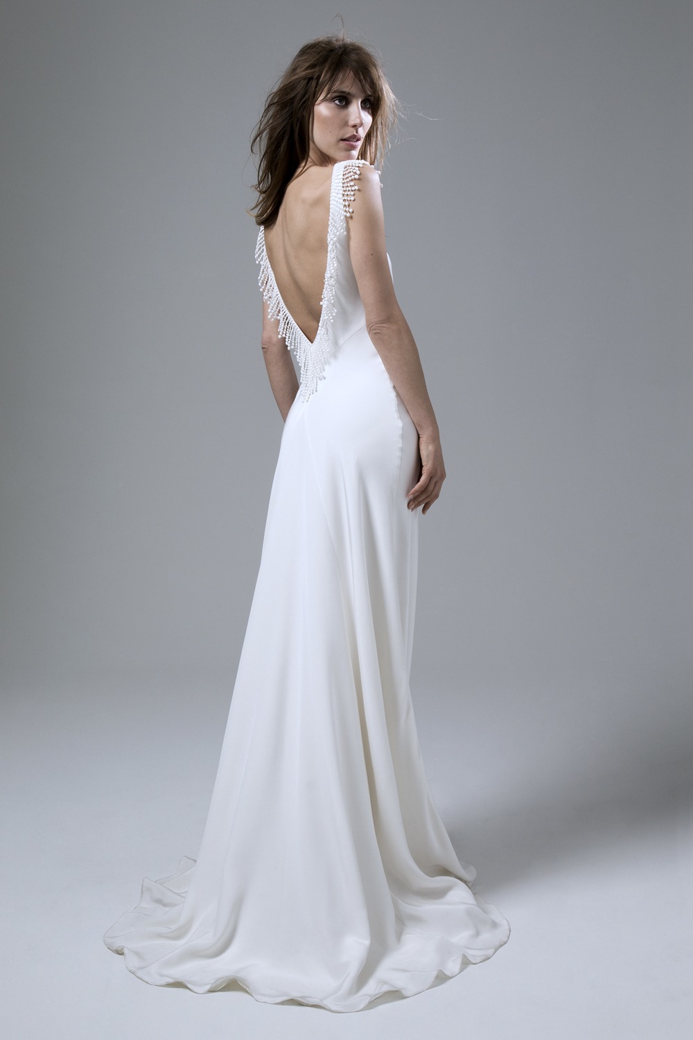 Silk crepe bias cut Vera wedding dress with French knot detail and plunging low back by Halfpenny London