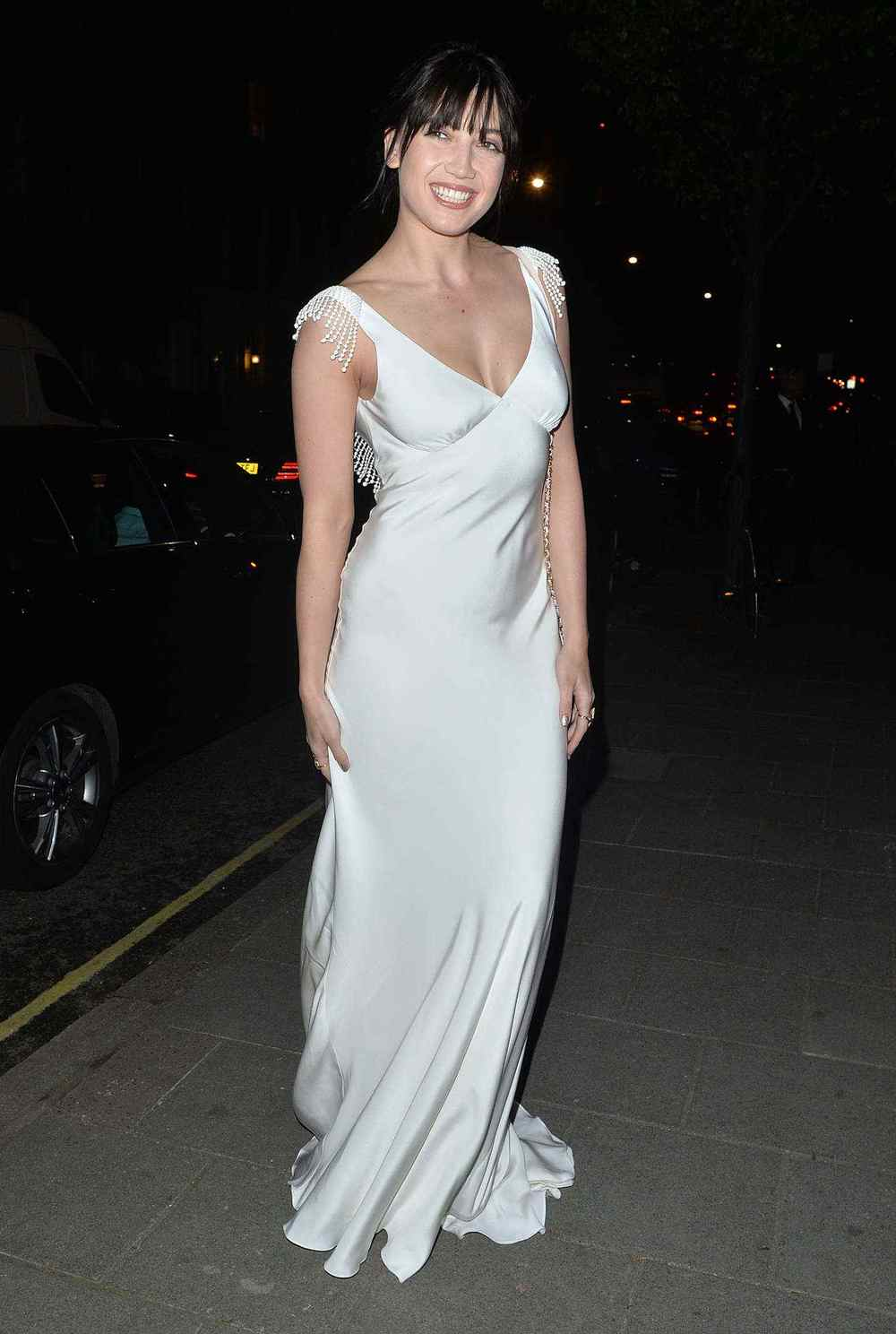 Daisy Lowe wears the silk crepe bias cut Vera wedding dress with French knot detail and plunging low back by Halfpenny London