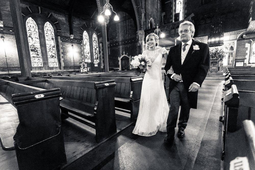 Beautiful bride Alexandra wore the Violet lace wedding dress by Halfpenny London with plunging back, lace cap sleeves and long train