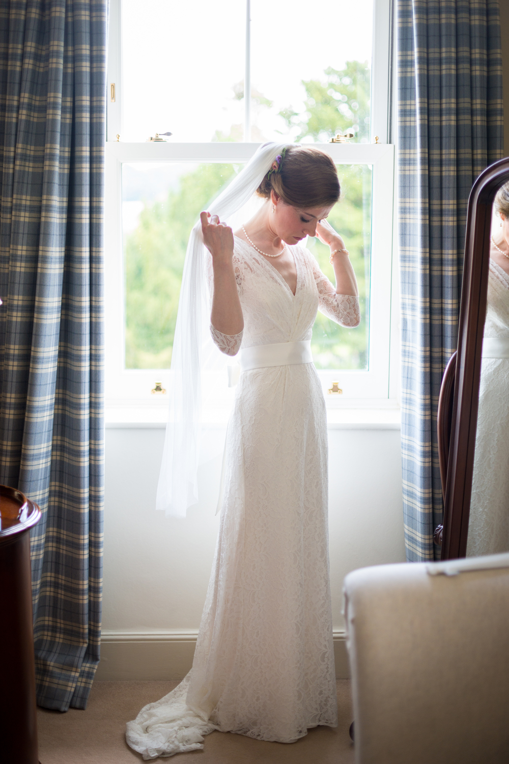 Freya wears the Halfpenny London Josephine wedding dress with a broad sash and fine tulle veil