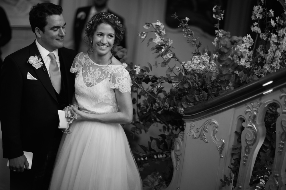 Lovely bride Eleanor wears the Iris backless French lace jacket worn with the Dita Tulle skirt and a floor length narrow french lace border veil by Halfpenny London