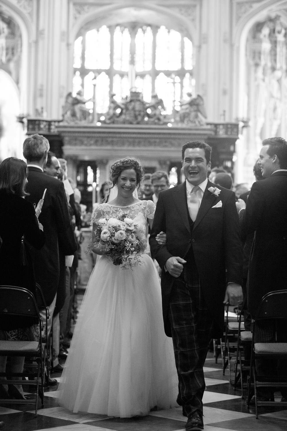 Lovely bride Eleanor wears the Iris backless French lace jacket worn with the Dita Tulle skirt and a floor length narrow french lace border veil by Halfpenny London 8.jpg