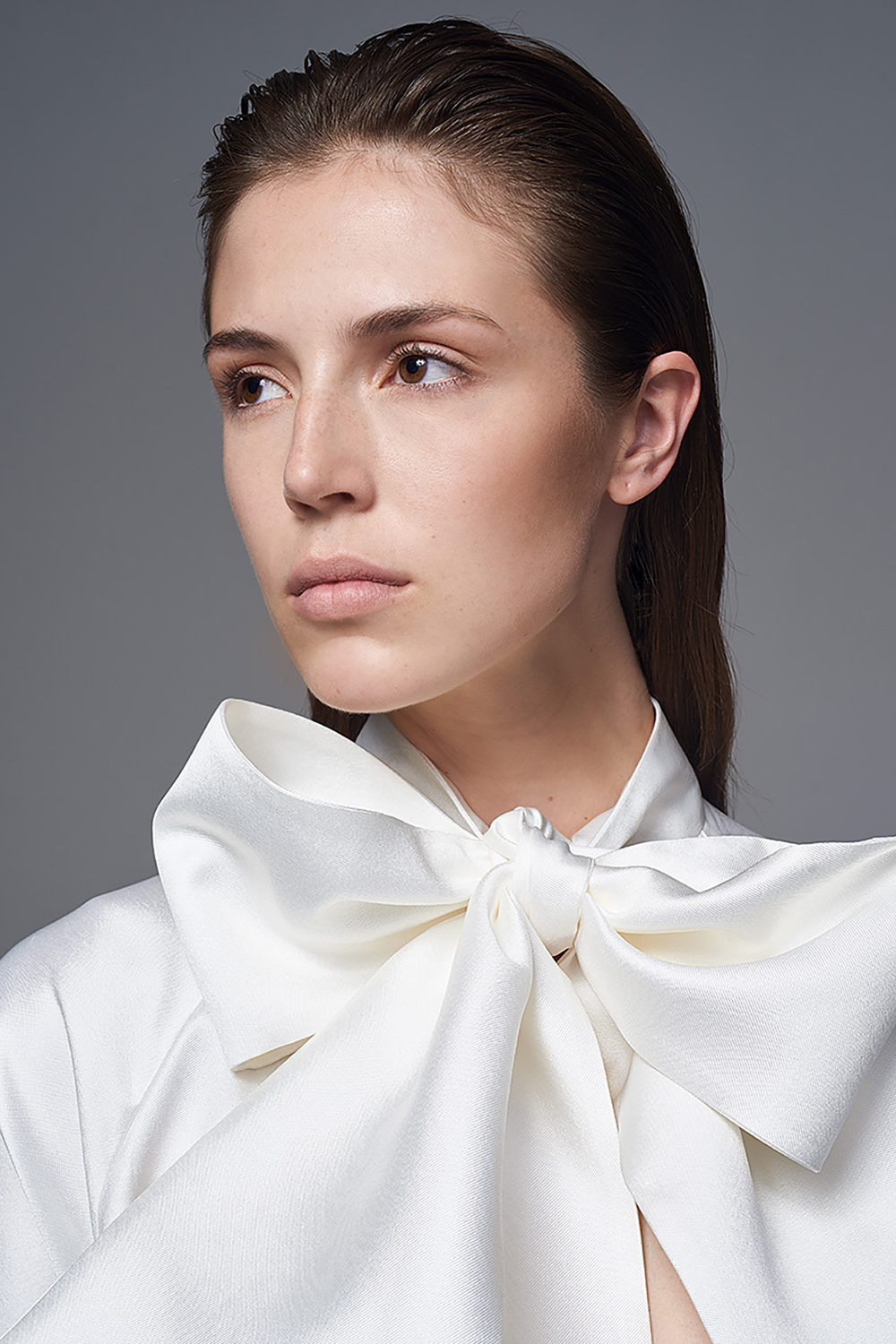 DETAIL VIEW OF THE BOW JACKET WITH ALEXA SKIRT TWO PIECE BRIDAL WEDDING DRESS BY HALFPENNY LONDON