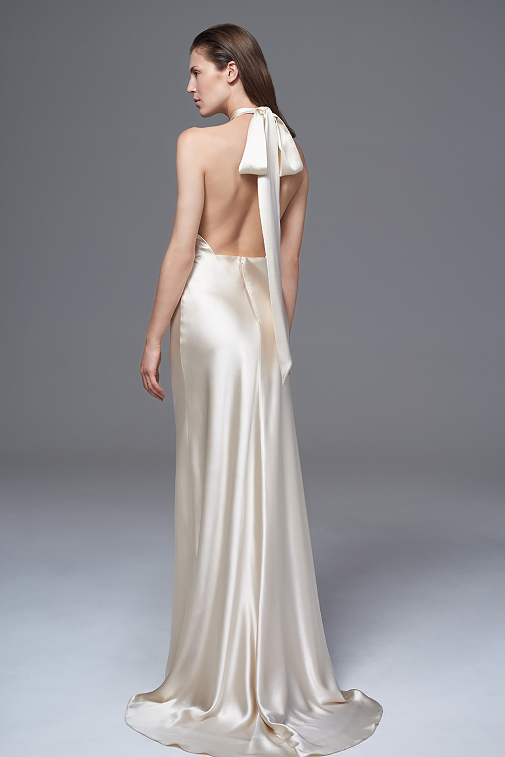 THE CHERYL BACKLESS DRESS WITH SATIN NECK TIE FITTED SKIRT AND PUDDLE TRAIN. BRIDAL WEDDING DRESS BY HALFPENNY LONDON