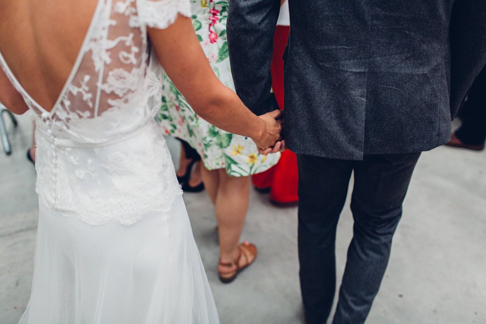 Gorgeous bride Jaye wears a lace, backless wedding dress by Halfpenny London