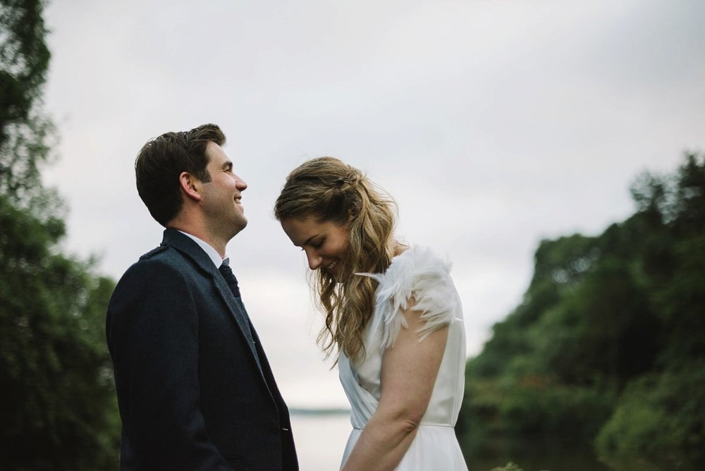 Beautiful Saskia wears a wedding dress by halfpenny London featuring a stunning V back and feather sleeves