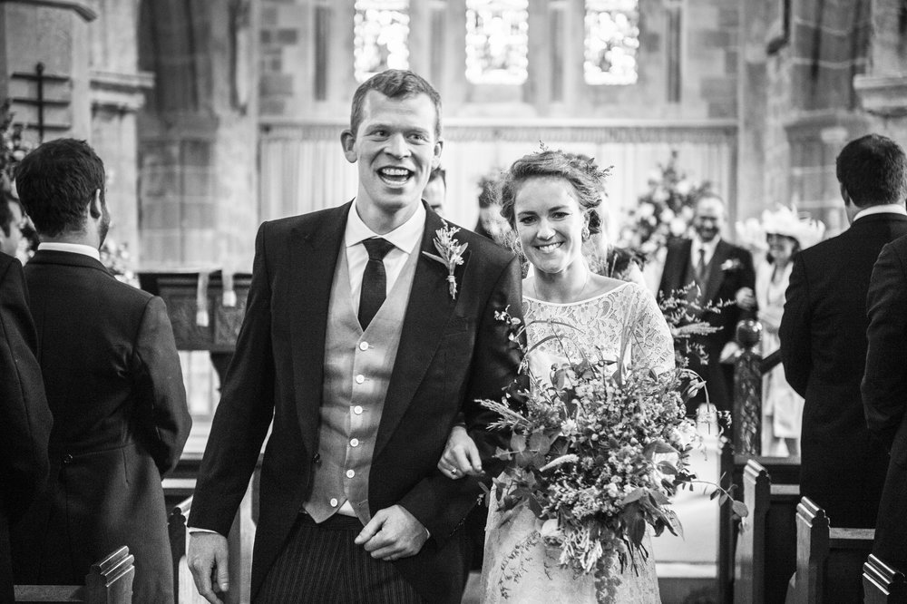 Beautiful bride Imogen wore a lace wedding dress by Halfpenny London