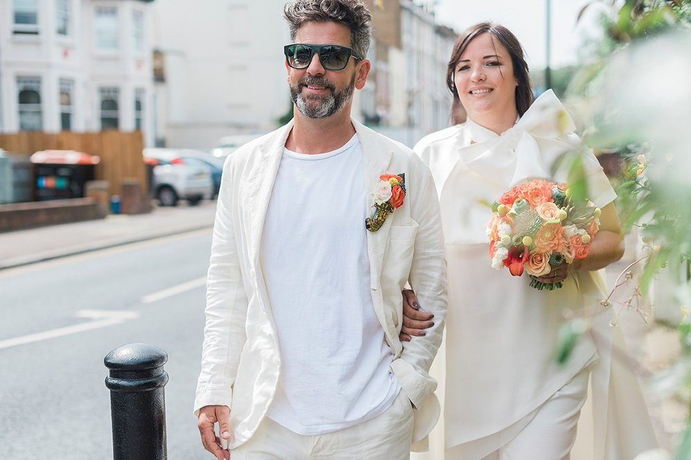Beautiful bride Jess wore the Halfpenny London Bow jacket for her laid back London wedding