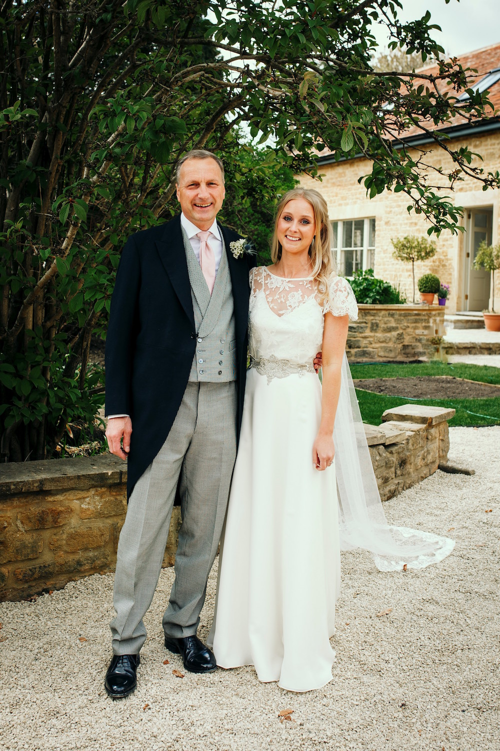 Beautiful bride Jess wore a wedding dress by Halfpenny London
