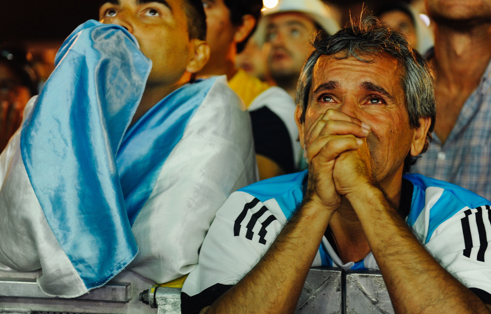 Man cries and prays in the last minutes of the match.