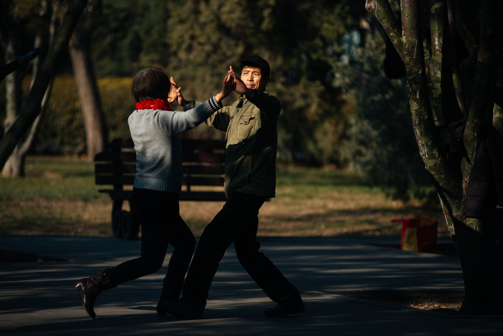 "Couple ""square dances"" in Ritan Park. In China it is very common to see couples dancing in parks or on the streets every day."