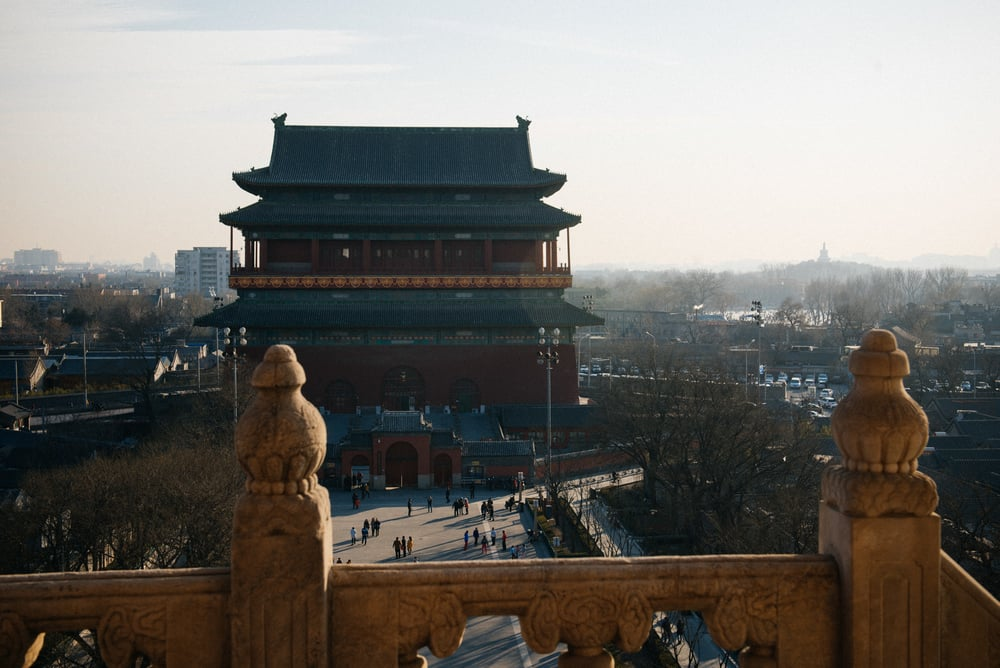 View of the Drum Tower from the top of the Bell Tower. In the back, to the right, you can see part of the frozen Houhai lake.