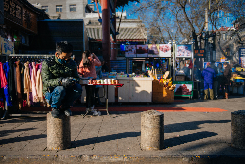 I call this guy birdman. It's a well known fact that in China people like to rest by crouching. Why this man decided to crouch on top of a post, I don't know. Doesn't seem comfortable to me.
