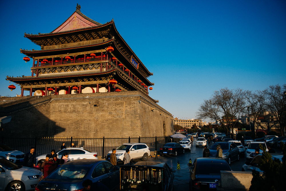 Drum tower of Xi'an, built in 1380, during the empire of Hongwu, Ming Dynasty. The Bell tower can be seen in the back, to the right, behind the trees.