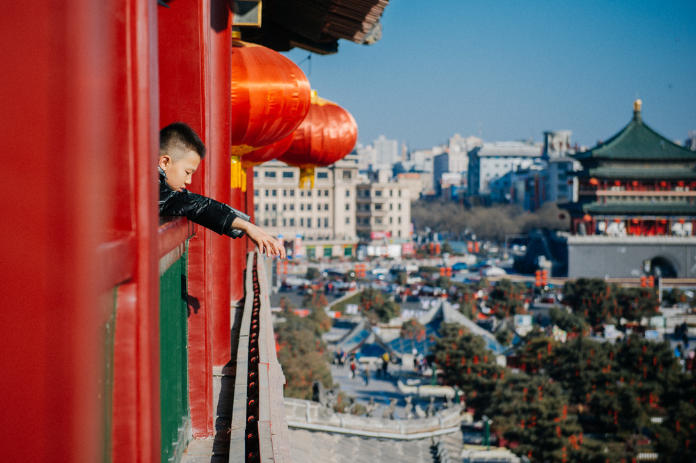 Boy looks down from the third floor of the Drum Tower. If you were wondering if the red lanterns are a seasonal decoration for the Chinese New Year, I can assure you that they are not. Even if you visit Xi'an during the summer months, you will be able to take a picture of the tower decorated with dozens of beautiful lanterns.
