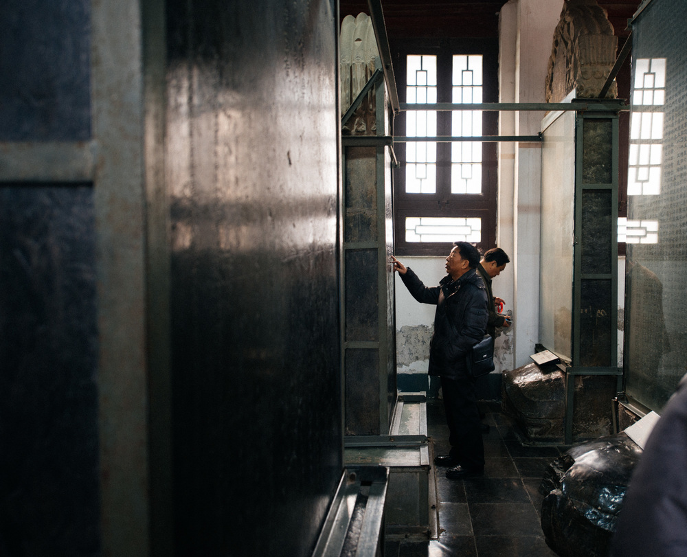 Some tablets are over one thousand years old, but that does not stop about every tourist from touching them. In room number five, the tablets from the Qing dynasty lay on the backs of  Bixi .
