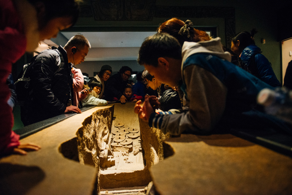 The place was packed. It was hard to even see the exhibits. Here, kids and adults pile themselves on a replica of a tomb.