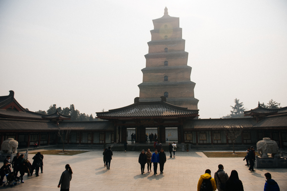 You can tell in which dynasty a building was made by the roof. The Tang dynasty architecture had those horn-like structures on top.