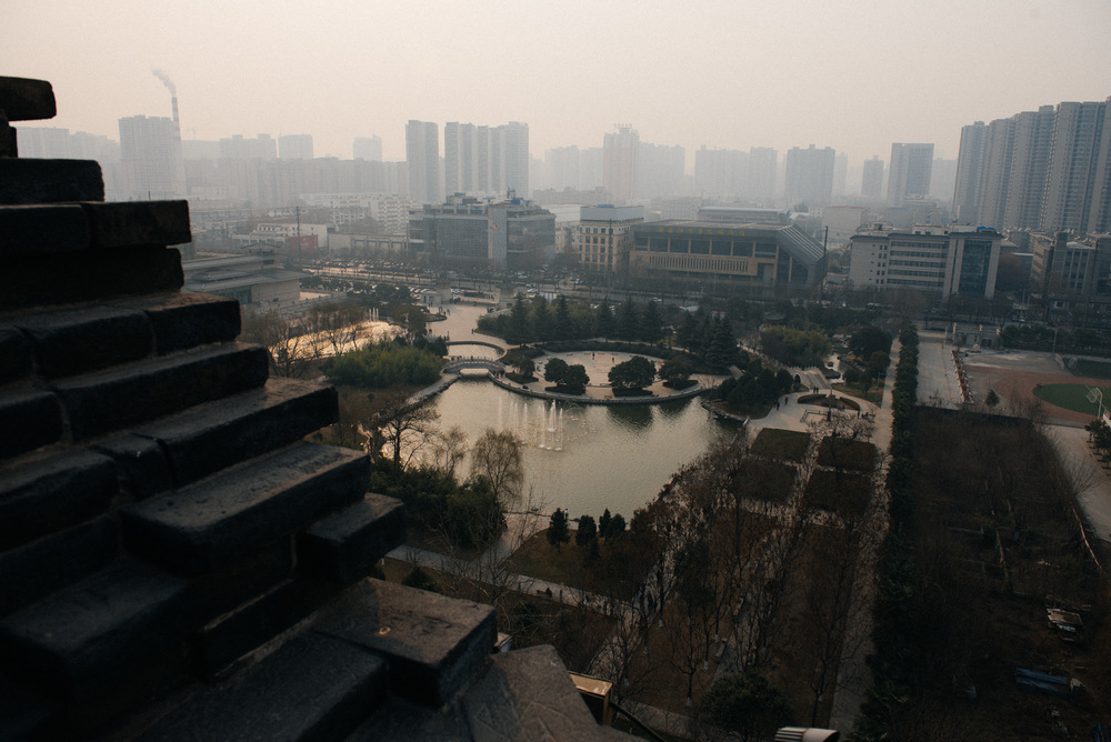 This is the view from the top. The pagoda is located outside the old city walls, surrounded by modern Xi'an, inside a park.