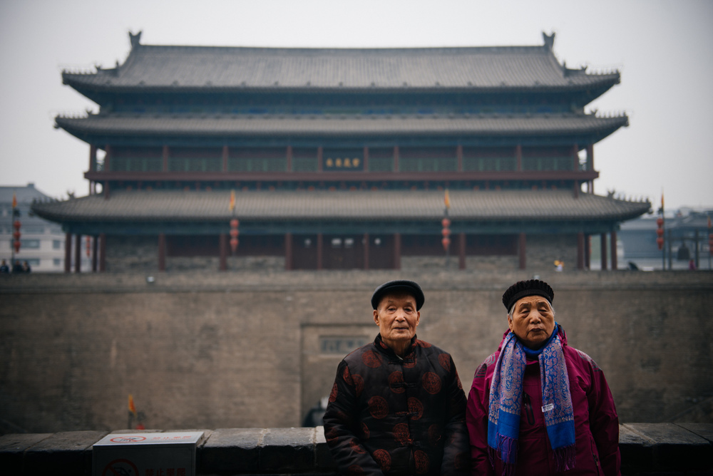 Senior couple poses for a photo in front ot the east gate barbican. If the enemy entered the first gate, they would be trapped and surrounded by the wall.