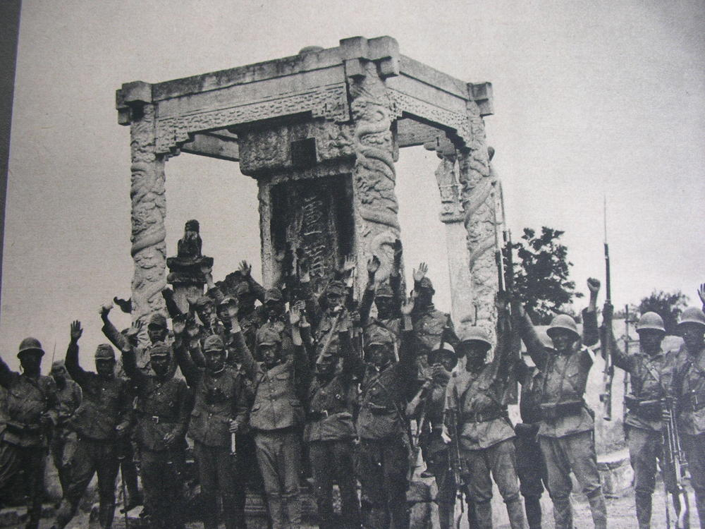 Japanese troops celebrate victory at the Lugou Bridge in 1937 (World War II Database)