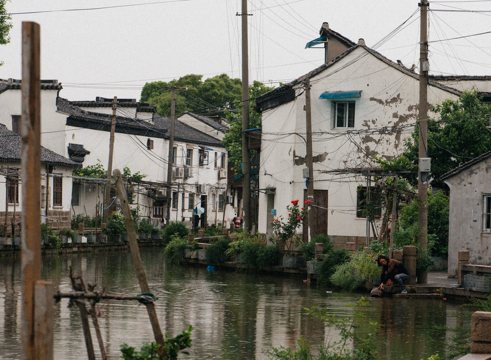 "This is the part of Shantang Street that is still untouched by the ""restoration"". Here many families still live and use the canals in their daily life."