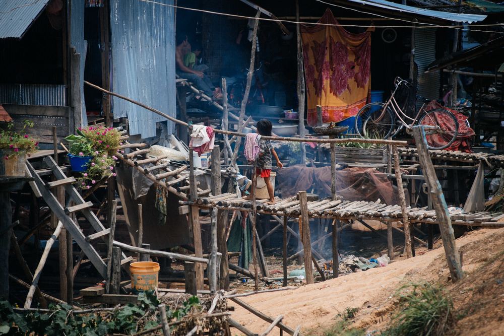 Villages like these are a common site in the countryside of Cambodia. Made with wood and construction leftovers, dozens of people live with no doors and little privacy.