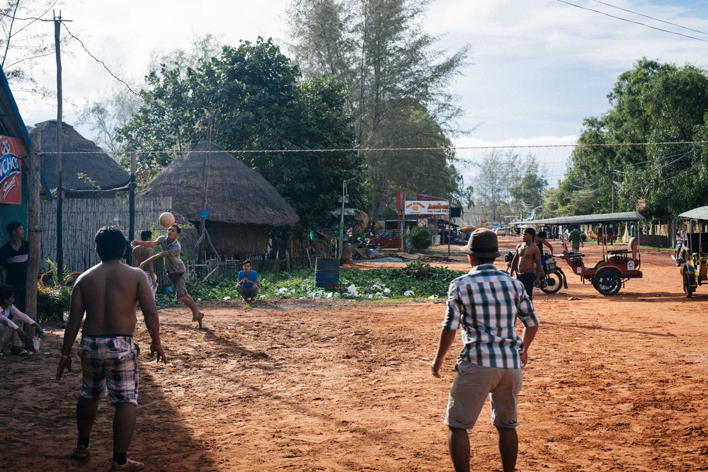 The locals like to play a version of volleyball, where you can't pass to your teammates and have to send the ball back over the net as soon as you get it. You also serve by using your feet.