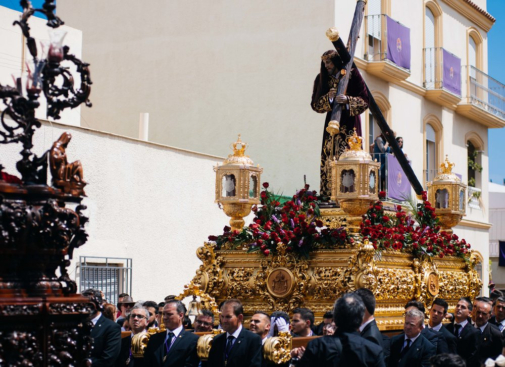 "Jesus of Nazareth is carried on the Streets of Vera by ""horquilleros"" who walk in rhythm so that it seems that the statue is floating over the crowd."