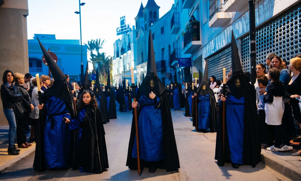 Penitents walk the streets of Vera during Holy Friday's procession. Children don't wear hoods because they can feel constricting.