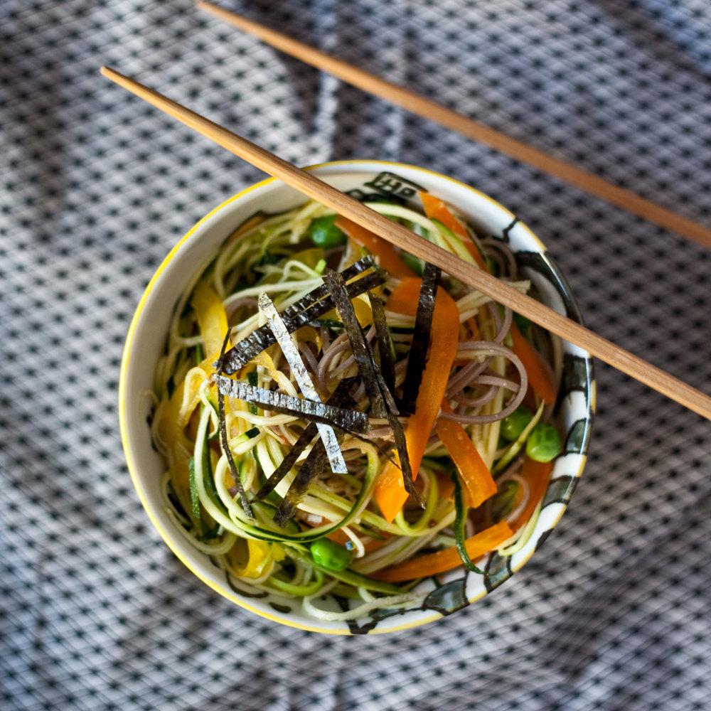 Green tea soba with seasonal vegetables and shredded nori.